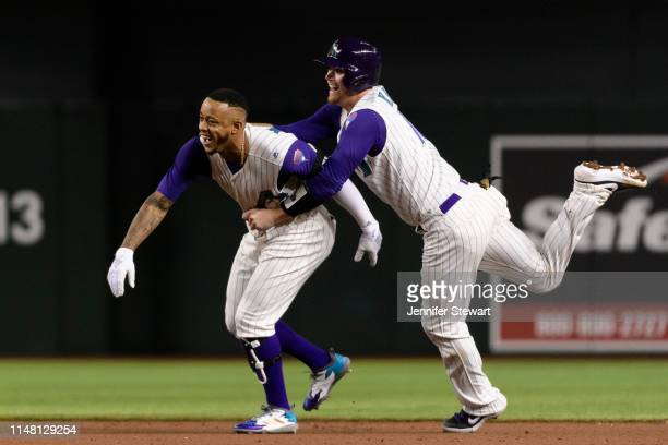 Ketel Marte of the Arizona Diamondbacks celebrates his walkoff single with Carson Kelly in the 10th inning of the MLB game against the Atlanta Braves...