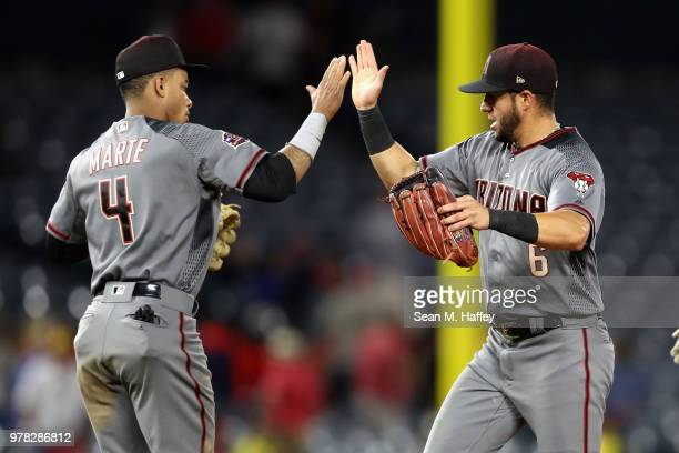 Ketel Marte of the Arizona Diamondbacks congratulates David Peralta of the Arizona Diamondbacks after defeating the Los Angeles Angels of Anaheim 74...