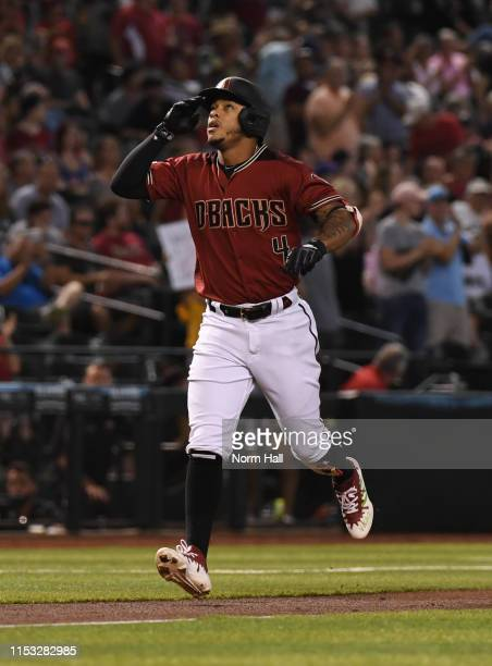 Ketel Marte of the Arizona Diamondbacks gestures to the sky after hitting a solo home run during the first inning against the New York Mets at Chase...
