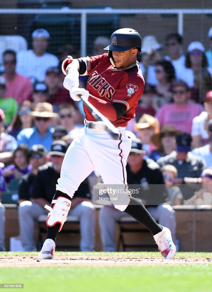Ketel Marte #4 of the Arizona Diamondbacks hits a double during the second inning of a spring training game against the Colorado Rockies at Salt River Fields at Talking Stick on March 12, 2018 in Scottsdale, Arizona.