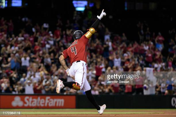 Ketel Marte of the Arizona Diamondbacks hits a grand slam in the seventh inning of the MLB game against the San Diego Padres at Chase Field on...