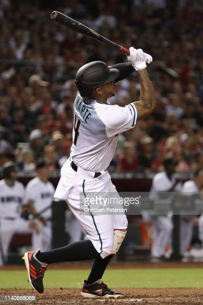 Ketel Marte of the Arizona Diamondbacks hits a grandslam home run against the Boston Red Sox during the sixth inning of the MLB game at Chase Field...