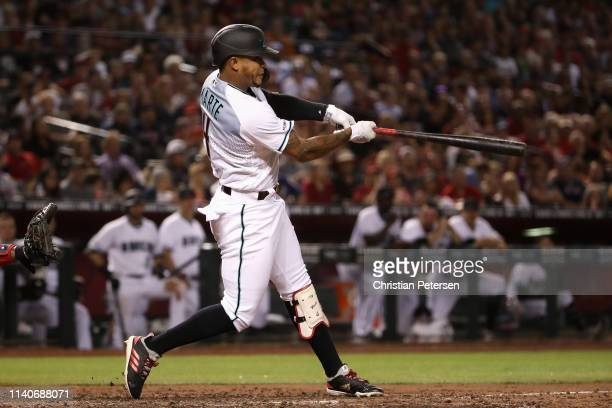 Ketel Marte of the Arizona Diamondbacks hits a grand-slam home run against the Boston Red Sox during the sixth inning of the MLB game at Chase Field...
