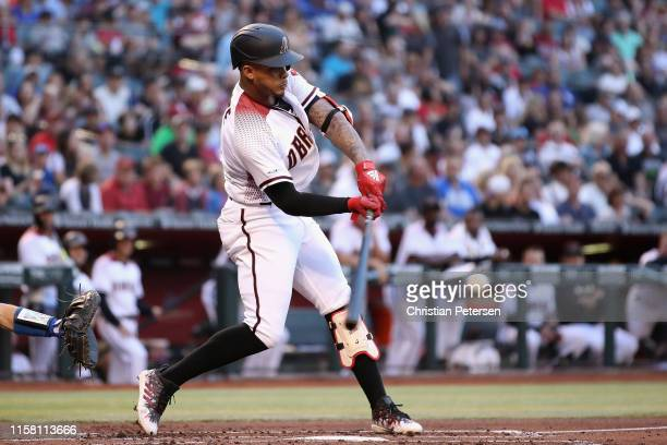 Ketel Marte of the Arizona Diamondbacks hits a single against the Los Angeles Dodgers during the first inning of the MLB game at Chase Field on June...