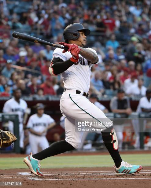 Ketel Marte of the Arizona Diamondbacks hits a triple against the San Francisco Giants during the first inning of the MLB game at Chase Field on June...