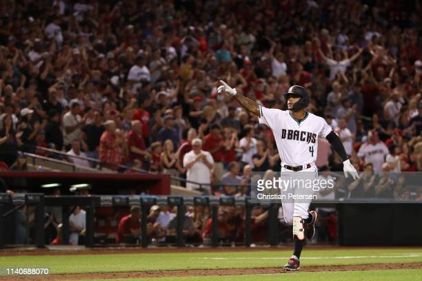 Ketel Marte of the Arizona Diamondbacks reacts after hitting a grandslam home run against the Boston Red Sox during the sixth inning of the MLB game...
