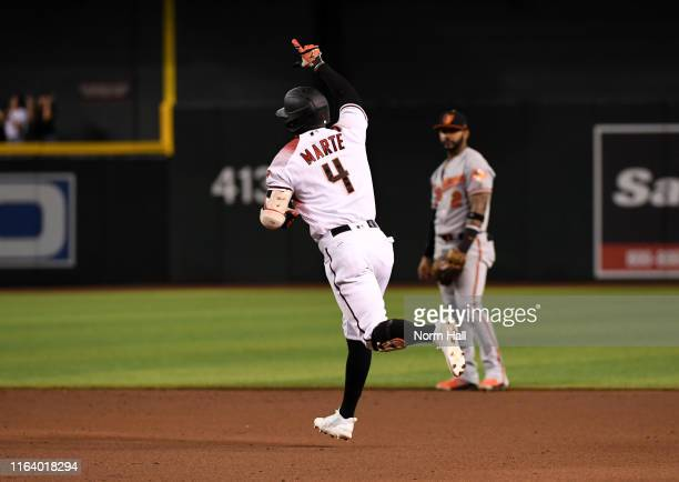 Ketel Marte of the Arizona Diamondbacks rounds the bases after hitting a solo home run against the Baltimore Orioles during the sixth inning at Chase...