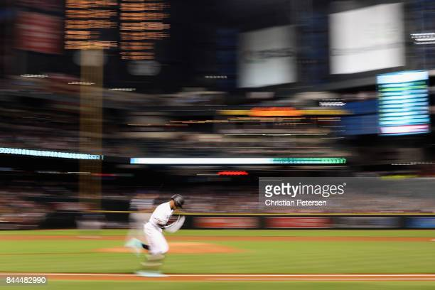 Ketel Marte of the Arizona Diamondbacks runs out a single during the first inning of the MLB game against the San Diego Padres at Chase Field on...