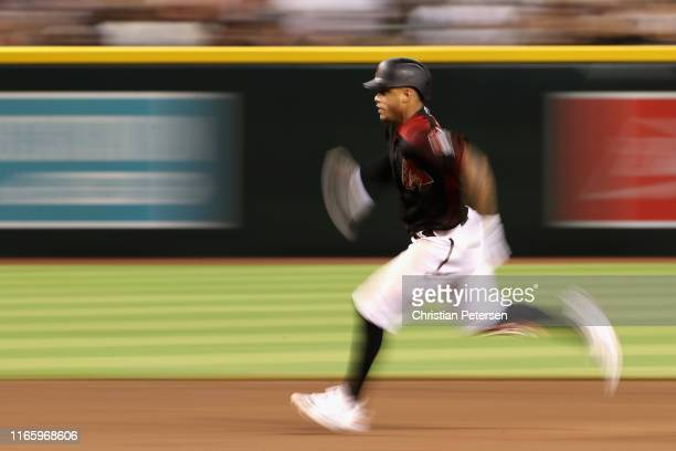 Ketel Marte of the Arizona Diamondbacks runs out a triple during the fifth inning of the MLB game against the Washington Nationals at Chase Field on...