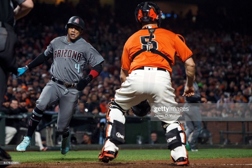 Ketel Marte #4 of the Arizona Diamondbacks scores a run past Nick Hundley #5 of the San Francisco Giants during the seventh inning at AT&T Park on September 15, 2017 in San Francisco, California. The Arizona Diamondbacks defeated the San Francisco Giants 3-2.