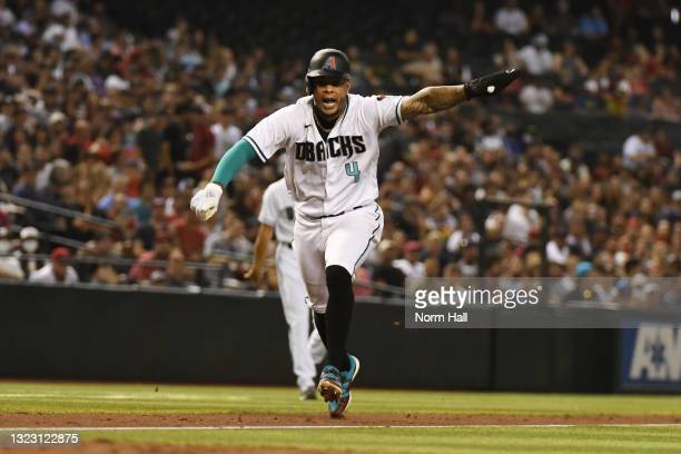 Ketel Marte of the Arizona Diamondbacks scores on a wild pitch by Shohei Ohtani of the Los Angeles Angels during the fifth inning at Chase Field on...