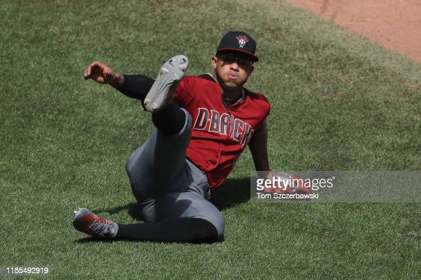 Ketel Marte of the Arizona Diamondbacks slides as he is unable to get to a single hit by Danny Jansen of the Toronto Blue Jays in the seventh inning...