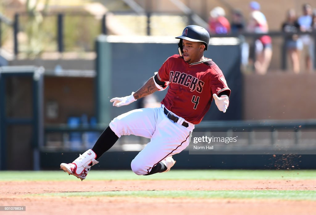 Ketel Marte #4 of the Arizona Diamondbacks slides into second base after hitting a double during the second inning of a spring training game against the Colorado Rockies at Salt River Fields at Talking Stick on March 12, 2018 in Scottsdale, Arizona.