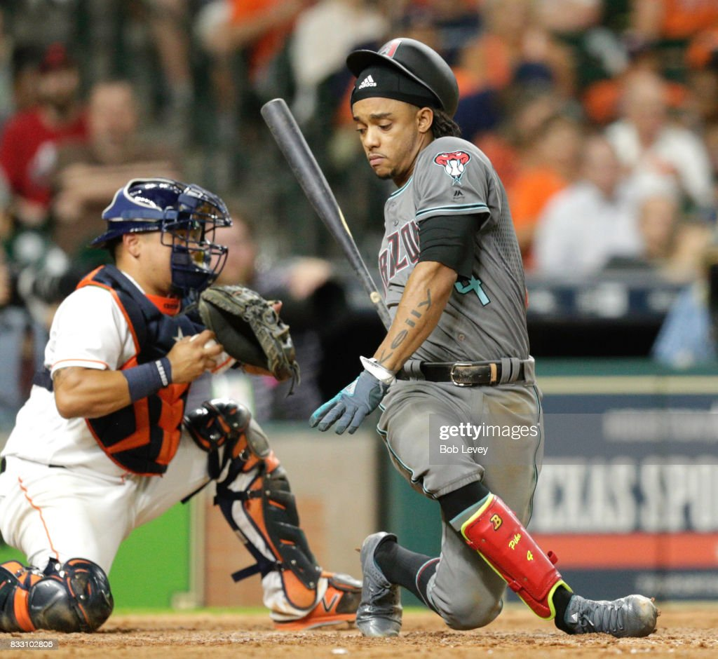 Ketel Marte #4 of the Arizona Diamondbacks swings through a pitch from Tyler Clippard of the Houston Astros in the seventh inning as Juan Centeno #30 holds onto the ball at Minute Maid Park on August 16, 2017 in Houston, Texas.