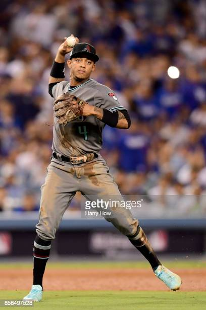Ketel Marte of the Arizona Diamondbacks throws the ball to first base in the fourth inning on a ball hit by Yasiel Puig of the Los Angeles Dodgers in...