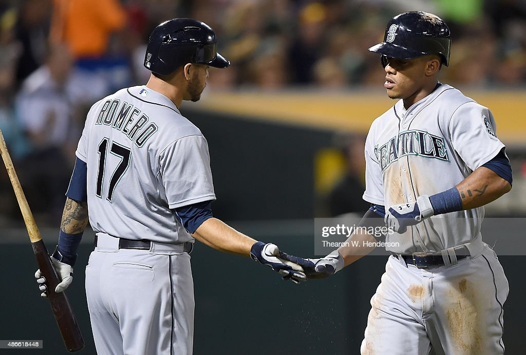 Ketel Marte #4 of the Seattle Mariners is congratulated by Stefen Romero #17 after Marte scored against the Oakland Athletics in the top of the third inning at O.co Coliseum on September 4, 2015 in Oakland, California.