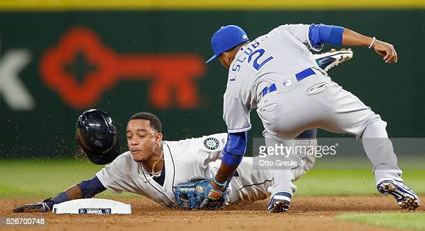 Ketel Marte of the Seattle Mariners is tagged out on a steal attempt at second base by shortstop Alcides Escobar of the Kansas City Royals in the...