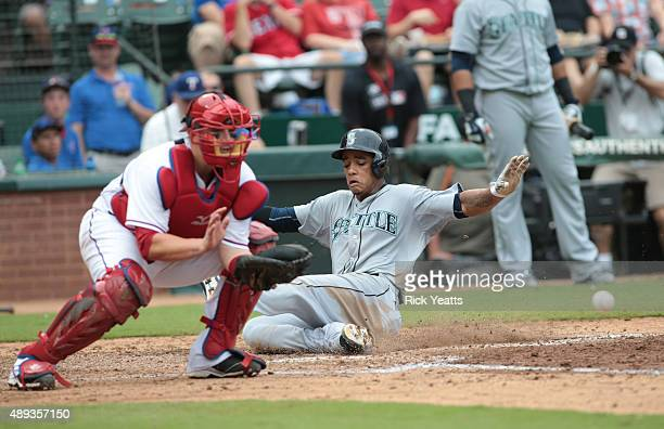 Ketel Marte of the Seattle Mariners slides in safe Bobby Wilson of the Texas Rangers in the fifth inning at Global Life Park in Arlington on...
