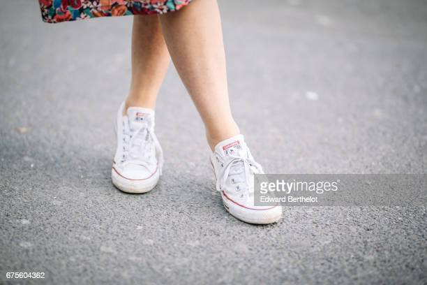 Ketevan Giorgadze blogger KatieOne wears a hat Converse All Stars white sneakers and a floral print pink dress from the brand Go Ask Alice next to...