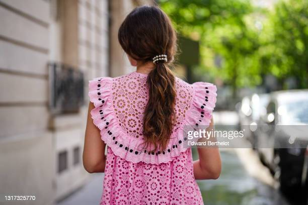 """Ketevan Giorgadze @katie.one wears a pink babydoll sleeveless mini dress with embroidery """"broderie anglaise"""" from Manoush, pearl pony cuff from Lelet..."""
