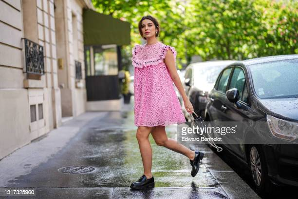 """Ketevan Giorgadze @katie.one wears a pink babydoll sleeveless mini dress with embroidery """"broderie anglaise"""" from Manoush, a black leather pearl bag..."""