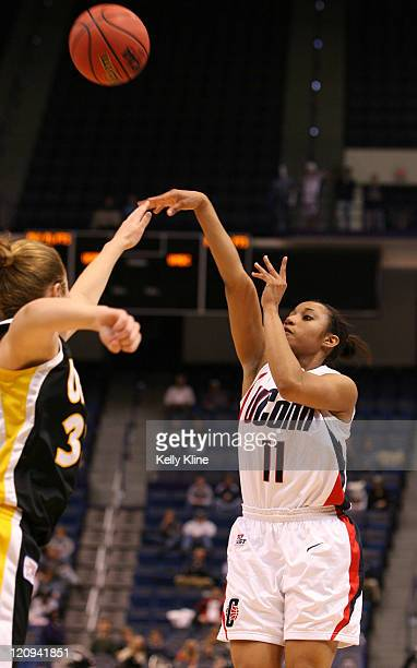 Ketia Swanier of UConn shooting over the UMBC defense in the first half of UMBC's first ever NCAA tournament appearance at the Hartford Civic Center...