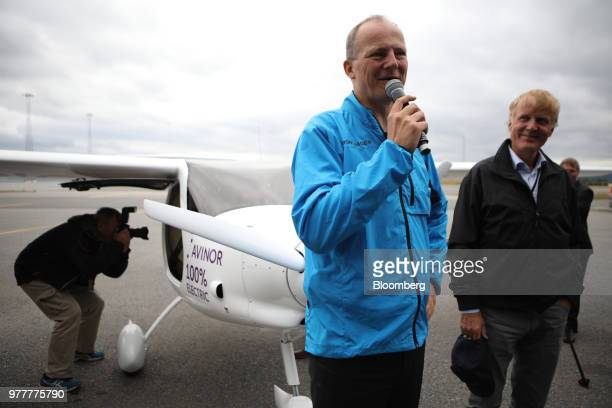 Ketil SolvikOlsen Norway's transport minister left speaks while standing beside an Avinor AS Alpha Electro G2 electric twoseater plane with Dag...