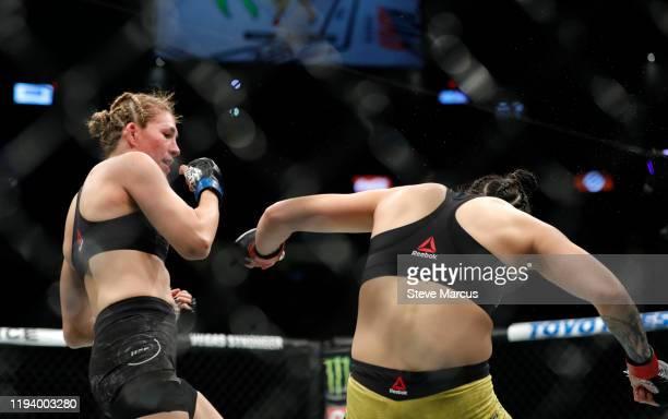 Ketlen Vieira is knocked down by Irene Aldana in a bantamweight fight during UFC 245 at TMobile Arena on December 14 2019 in Las Vegas Nevada Aldana...