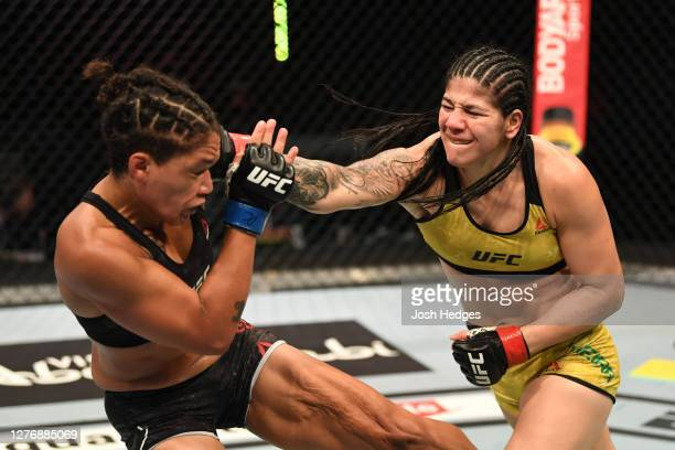 Ketlen Vieira of Brazil punches Sijara Eubanks in their women's bantamweight bout during UFC 253 inside Flash Forum on UFC Fight Island on September...