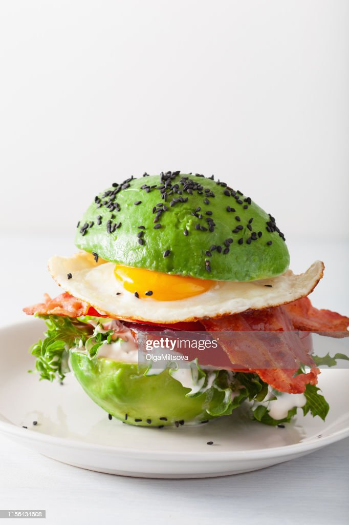 keto paleo diet avocado breakfast burger with bacon, egg, tomato : Stock Photo