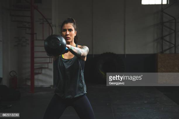 kettle bell exercises - one young woman only stock pictures, royalty-free photos & images