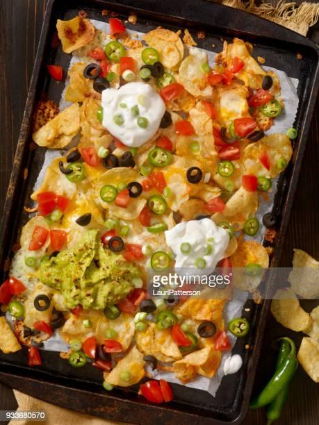 kettle cooked potato chip nachos - nachos stock photos and pictures