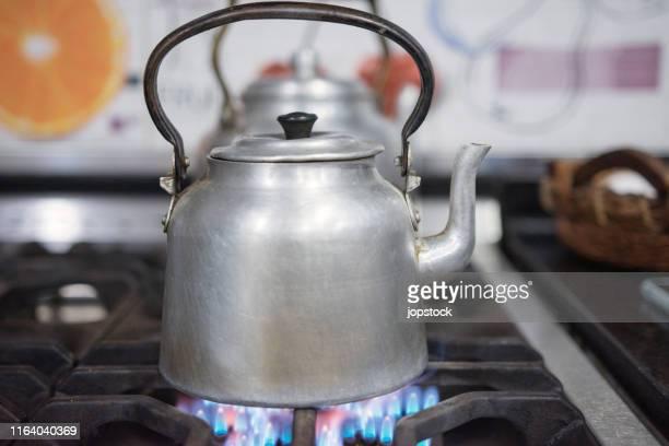 kettle on stove - やかん ストックフォトと画像
