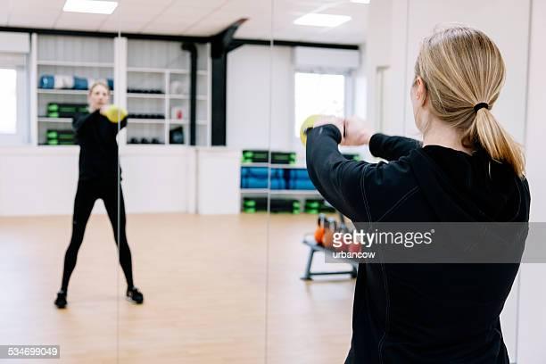 Kettlebell strength training class in an exercise studio