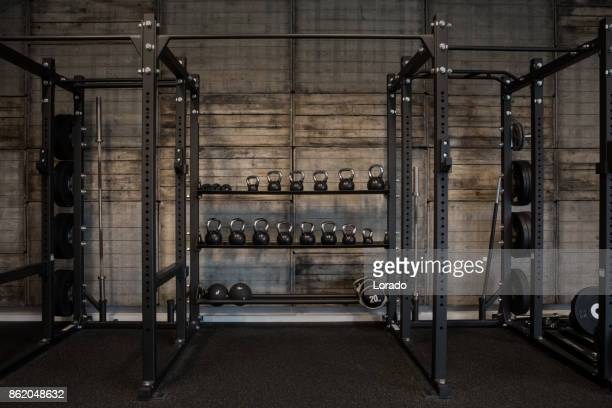 kettlebells in gym setting - exercise equipment stock pictures, royalty-free photos & images