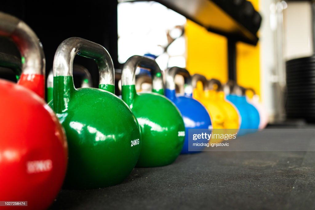 Kettlebells in the gym : Stock Photo