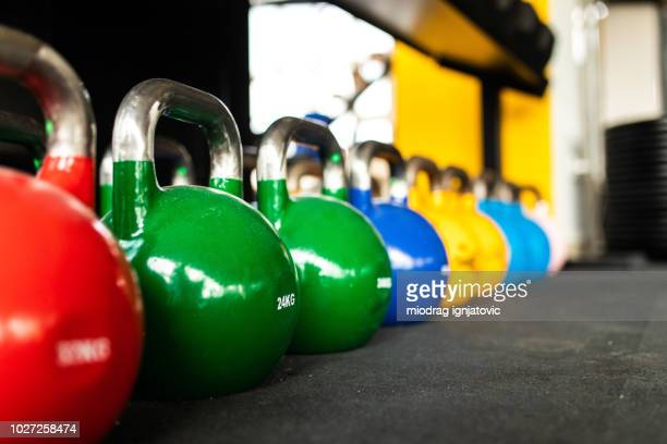 kettlebells in the gym - mass unit of measurement stock pictures, royalty-free photos & images