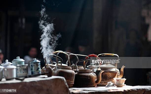 Kettles on stove in old tea house, Chengdu, China