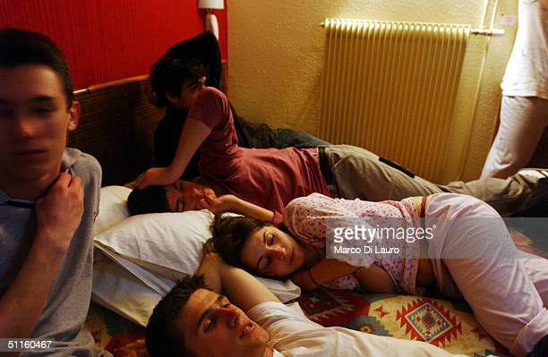 Ketty Piani an Italian student from the Primo Levi Technical Institute of Vignola in the Modena Province lies on her hotel bed with her classmate...