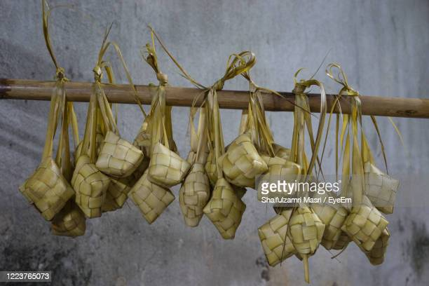 ketupat is a natural rice casing made from young coconut leaves for cooking rice. - shaifulzamri stock pictures, royalty-free photos & images