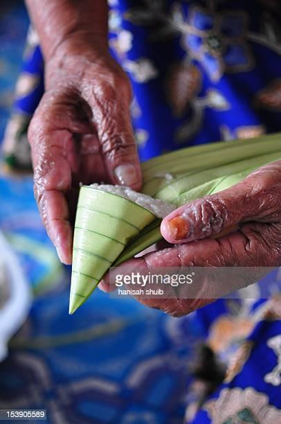 Ketupat palas in making