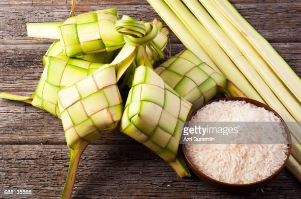 ketupat (rice dumpling on white background) - hari raya celebration stock pictures, royalty-free photos & images