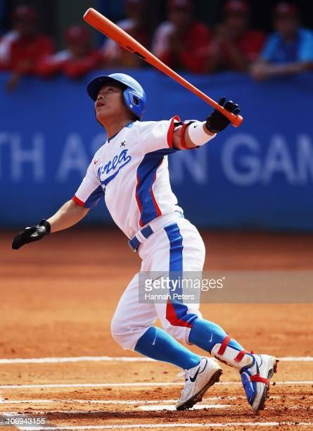 Keunwoo Jeong of Korea bats during the baseball match between Korea and China during day six of the 16th Asian Games Guangzhou 2010 at Aoti Baseball...