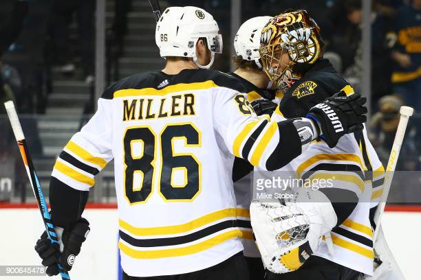 Kevan Miller and Tuukka Rask of the Boston Bruins celebrate a 51 win against the New York Islanders at Barclays Center on January 2 2018 in New York...