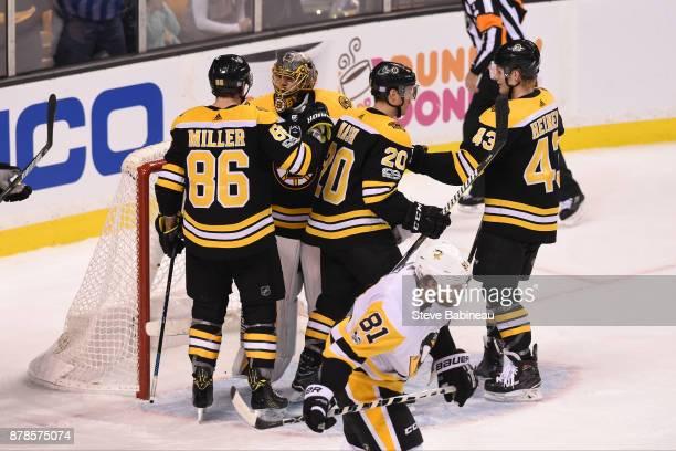 Kevan Miller, Anton Khudobin, Riley Nash and Danton Heinen of the Boston Bruins celebrate a win against the Pittsburgh Penguins at the TD Garden on...