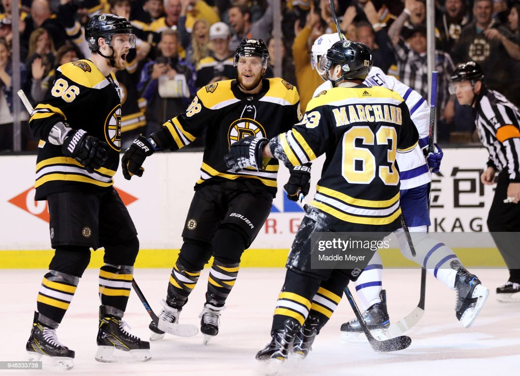 Kevan Miller #86 of the Boston Bruins celebrates with David Pastrnak #88 and Brad Marchand #63 after scoring a goal against the Toronto Maple Leafs during the first period of Game Two of the Eastern Conference First Round during the 2018 NHL Stanley Cup Playoffs at TD Garden on April 14, 2018 in Boston, Massachusetts.