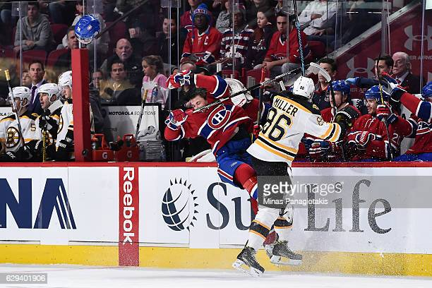 Kevan Miller of the Boston Bruins checks Alexei Emelin of the Montreal Canadiens during the NHL game at the Bell Centre on December 12 2016 in...