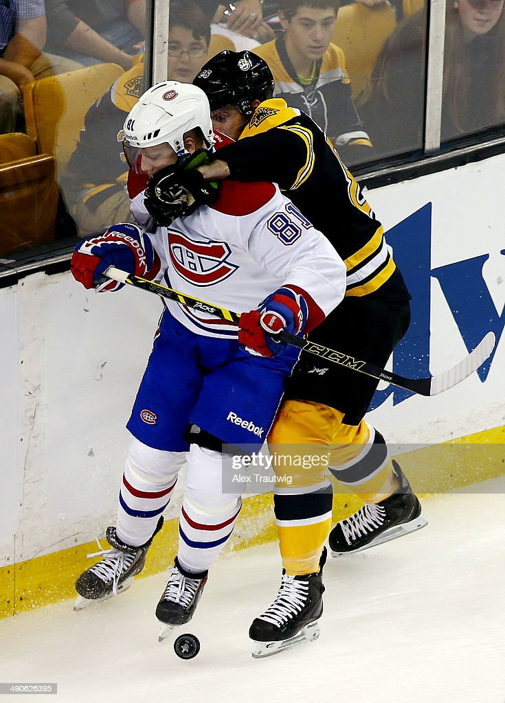 Kevan Miller #86 of the Boston Bruins checks Lars Eller #81 of the Montreal Canadiens during Game Seven of the Second Round of the 2014 NHL Stanley Cup Playoffs at the TD Garden on May 14, 2014 in Boston, Massachusetts.