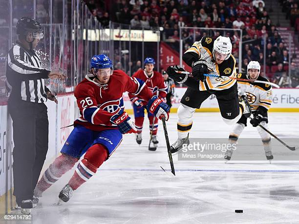 Kevan Miller of the Boston Bruins jumps as Jeff Petry of the Montreal Canadiens skates the puck during the NHL game at the Bell Centre on December 12...
