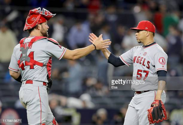 Kevan Smith and Hansel Robles of the Los Angeles Angels celebrate the 32 win over the New York Yankees at Yankee Stadium on September 18 2019 in the...